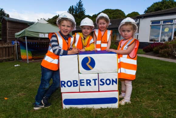 Noah Francis (4), Matthew Thomas (4), Mollie Campbell (4) and Amelia Campbell (3) build the Robertson Block - The Courier