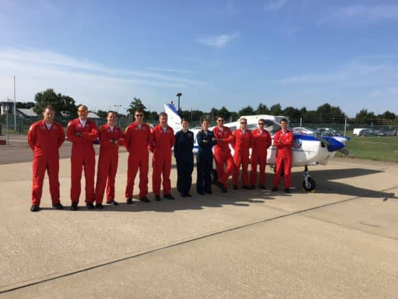 Claire and Rachel with the pilots of the Royal Air Force Aerobatic Team; the Red Arrows at Norwich Airport, on the 3rd stage of the 'Evie' tour.