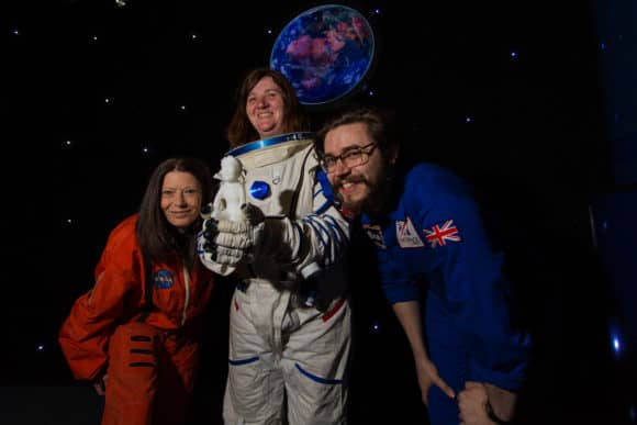 Karen McAulay, Ashley Wallace (Advocating Together Dundee) and Paul Strachan (DSC) with the model Oor Wullie that is taking a trip to the edges of space in a weather balloon. Credit: D C Thomson.