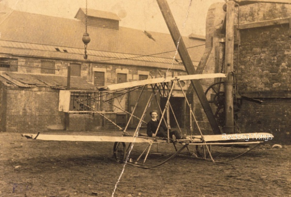 Credit: The Trustees of the National Museums of Scotland - David Urquhart seated in Preston Watson's first aeroplane, after removing its engine and modifying it into a successful glider.