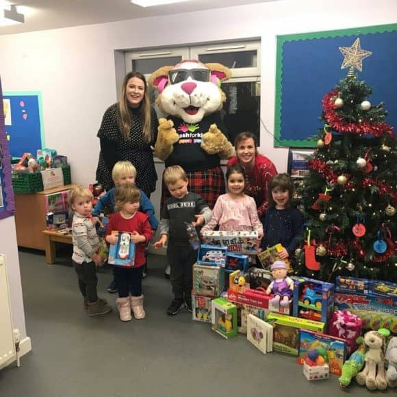 Courage the Cat collecting the children's toy donations!